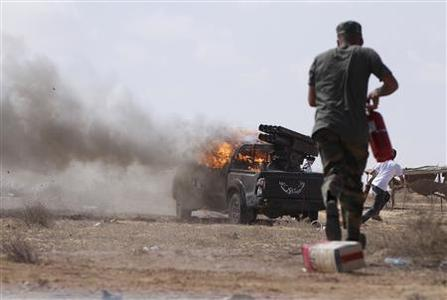 Forces loyal to Libya's interim rulers fire rockets from an area about 2 km from the centre of the coastal city of Sirte September 28, 2011. REUTERS/Anis Mili