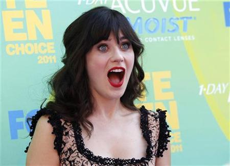 Actress Zooey Deschanel arrives at the Teen Choice Awards in Los Angeles August 7, 2011. REUTERS/Danny Moloshok