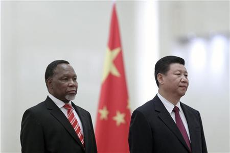 Chinese Vice President Xi Jinping (R) and South Africa's Vice President Kgalema Motlanthe listen to the national anthems during a welcoming ceremony inside the Great Hall of the People in Beijing, China September 28, 2011. REUTERS/ Feng Li/Pool