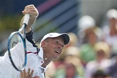 Российский теннисист Николай Давыденко на турнире в Монреале, 10 августа 2011 года. Россиянин Николай Давыденко успешно миновал барьер второго круга на турнире Malaysian Open, проходящем в Куала-Лумпур, и вышел в четвертьфинал. REUTERS/Christinne Muschi