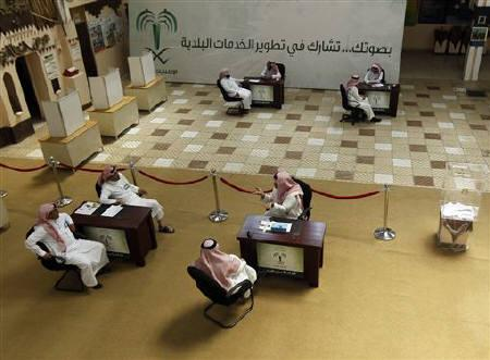 Officials wait for voters at a polling station at Prince Salman center in Riyadh September 29, 2011. REUTERS/Fahad Shadeed
