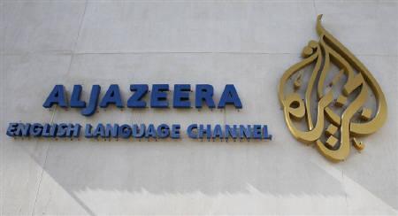 The logo of Qatar-based Al Jazeera satellite news channel is seen in Doha February 7, 2011. REUTERS/ Fadi Al-Assaad/Files