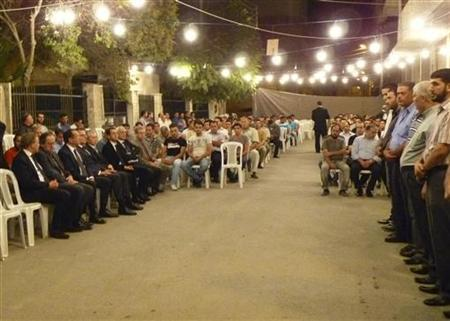 Robert Ford, the U.S. ambassador in Syria, is seen seated (L) with together with the ambassadors of Britain and France at the wake of 25-year-old Ghayath Mater in the Damascus suburb of Daraya September 11, 2011. REUTERS/Handout
