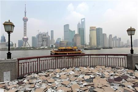 Shanghai's new financial district skyline is seen from the opposite side of Huang Pu river, which is under re-construction as part of a city facelift for the upcoming 2010 World Expo, in Shanghai July 1, 2009. REUTERS/ Aly Song