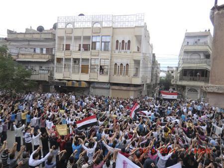 Demonstrators protesting against Syria's President Bashar al-Assad march through the streets in Homs September 30, 2011. Picture taken September 30, 2011. REUTERS/Handout