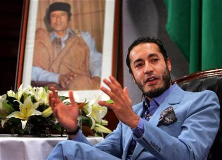 Al Saadi Gaddafi, the third son of Libyan leader Muammar Gaddafi, speaks at a news conference in Sydney. REUTERS/Tim Wimborne