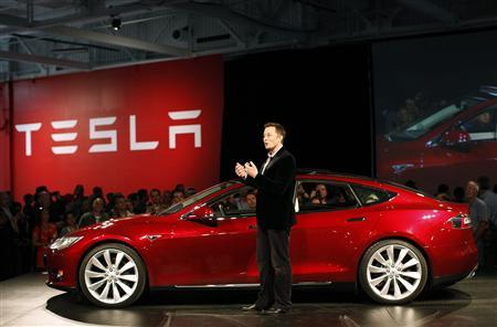 Tesla Motors CEO Elon Musk speaks next to the comany's newest Model S during the Model S Beta Event held at the Tesla factory in Fremont, California October 1, 2011. REUTERS/Stephen Lam