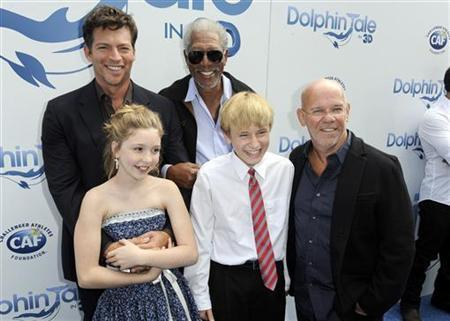 (Back L-R) Cast members, actors Harry Connick Jr., Morgan Freeman, (Front L-R) Cozi Zuehlsdorff, Nathan Gamble and director Charles Martin Smith arrive at the movie ''Dolphin Tale'' world premiere in Los Angeles, California September 17, 2011. REUTERS/Gus Ruelas