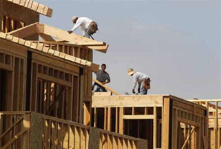 Construction workers are shown on a residential housing work site in Burbank, California July 27, 2011.  REUTERS/Fred Prouser/Files