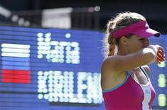 Теннисистка Мария Кириленко на турнире Pan Pacific Open в Токио, 29 сентября 2011 года. Российская теннисистка Мария Кириленко преодолела в понедельник барьер первого круга на турнире China Open в Пекине. REUTERS/Yuriko Nakao