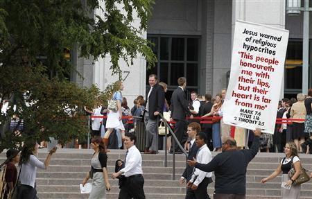 Christian street preachers protest as as faithful Mormons make their way to the conference center for the fifth session of the 181st Semiannual General Conference of the Church of Jesus Christ of Latter-day Saints in Salt Lake City, Utah, October 2, 2011. REUTERS/George Frey