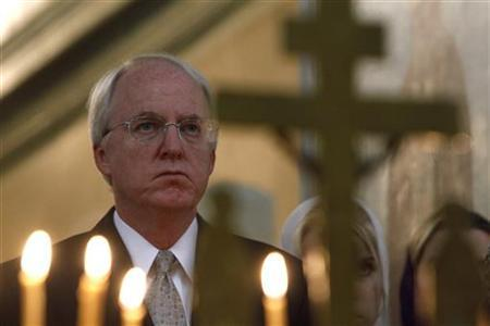 U.S. Ambassador to Russia John Beyrle attends an Orthodox service to commemorate the 10th anniversary of the 9/11 attacks on the World Trade Center in the U.S., at a church in Moscow September 11, 2011. REUTERS/Sergei Karpukhin