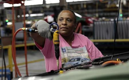 United Auto Workers union member assembly worker Ingrid Hill works on a Chevrolet Volt electric vehicle at General Motors Detroit-Hamtramck assembly plant in Hamtramck, Michigan, July 27, 2011. REUTERS/Rebecca Cook
