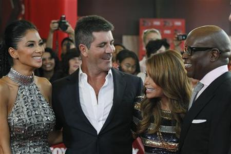 Nicole Scherzinger (L to R), Simon Cowell, Paula Abdul and Antonio Reid attend the world premiere of the television series ''The X Factor'' at the Arclight Cinerama Dome in Hollywood, California September 14, 2011. REUTERS/Mario Anzuoni
