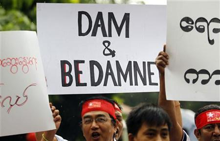 Myanmareses living in Malaysia display placards in protest against the Myitsone dam project, outside Myanmar's embassy in Kuala Lumpur September 22, 2011. REUTERS/Bazuki Muhammad