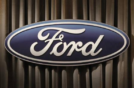 The Ford Motor Company logo is shown during the firm's annual meeting of shareholders in Wilmington, Delaware May 12, 2011. REUTERS/Tim Shaffer/Files