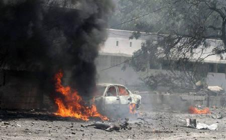 A car burns at the scene of a suicide attack in Somalia's capital Mogadishu, October 4, 2011. REUTERS/Omar Faruk/ATTENTION EDITORS - VISUALS COVERAGE OF SCENES OF DEATH AND INJURY