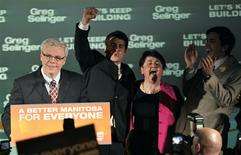 <p>Manitoba NDP leader Greg Selinger (L-R) celebrates with son Eric, wife Claudette Toupin-Selinger and son Pascal after winning the provincial election in Winnipeg, Manitoba October 4, 2011. REUTERS/Fred Greenslade</p>