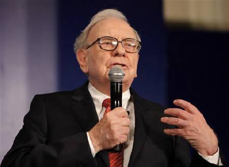 Billionaire Warren Buffett speaks during a news conference in New Delhi March 24, 2011. REUTERS/B Mathur/Files
