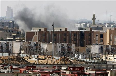 Smoke is seen rising over the city of Sirte, October 4, 2011, during clashes between anti-Gaddafi fighters and Gaddafi forces. REUTERS/Asmaa Waguih