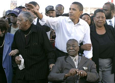 Barack Obama with Reverend Joseph Lowery (L), Reverend Fred Shuttlesworth (front) and Joann Bland (R) walk over the Edmund Pettus Bridge during a march commemorating the 1965 Selma-Montgomery Voting Rights March in Selma, Alabama, March 4, 2007. REUTERS/Tami Chappell