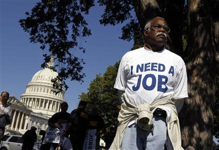 Mervin Sealy from Hickory, North Carolina, takes part in a protest rally outside the Capitol Building in Washington, October 5, 2011. Demonstrators were demanding that Congress create jobs, not make budget cuts during the protest. REUTERS/Jason Reed