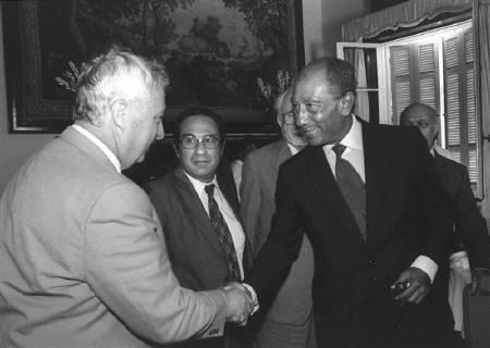 Egyptian President Anwar Sadat (R) shakes hands with Israeli Defence Minister Ariel Sharon (L) in Alexandria, Egypt, August 25, 1981 in this handout photo released by the Government Press Office. REUTERS/Herman Chanania/Government Press Office/Handout