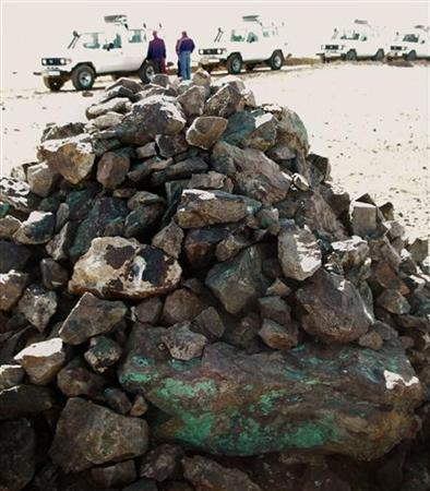 A traditional cairn of stones, including copper-rich ore, stands on the site of Oyu Tolgoi copper and gold mine in Mongolia November 10, 2007. REUTERS/Tom Miles