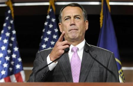 House Speaker John Boehner (R-OH) acknowledges a reporter during a news conference at the Capitol in Washington, September 22, 2011. REUTERS/Jonathan Ernst
