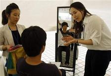 <p>A jobseeker (C) listens to a consultant's advice on how to prepare for possible interviews during a job fair in Seoul June 17, 2011. REUTERS/Truth Leem</p>