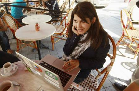 Tunisian blogger Lina Ben Mhenni, who has been tipped for the 2011 Nobel Peace Prize, works on her computer at  a cafe in Tunis October 6, 2011. REUTERS/Zoubeir Souissi