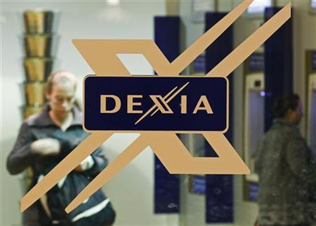 A woman walks inside a local branch of the Belgian-French financial services group Dexia in Brussels October 5, 2011.  REUTERS/Thierry Roge