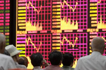 People look at an electronic board at a brokerage house in Shanghai July 26, 2010. REUTERS/Aly Song/Files