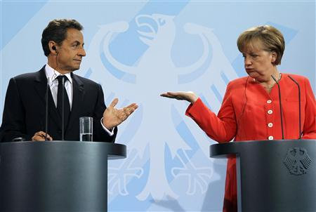 French President Nicolas Sarkozy and German Chancellor Angela Merkel gesture as they address a news conference at the Chancellery in Berlin, June 17, 2011. REUTERS/Fabrizio Bensch/Files