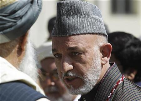 Afghan President Hamid Karzai talks to one of the elders during the funeral ceremony of former president Burhanuddin Rabbani, the government's chief peace negotiator, at the presidential palace in Kabul, September 23, 2011. REUTERS/Kamran Jebreili/Pool