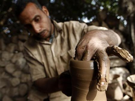 A man works at a small pottery factory in Cairo March 6, 2011. REUTERS/Peter Andrews