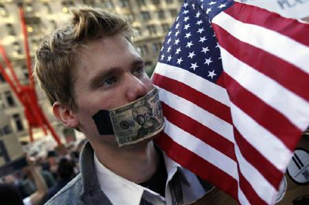An Occupy Wall Street protester marches up Broadway in New York City, October 5, 2011. REUTERS/Mike Segar
