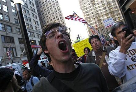 An Occupy Wall Street protester shouts slogans as he demonstrates in New York City, October 5, 2011.    REUTERS/Mike Segar