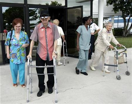 Residents of the Century Village retirement community in Deerfield Beach, Florida leave a polling station after voting in this November 2, 2004 file photo.   REUTERS/Gary I Rothstein/Files