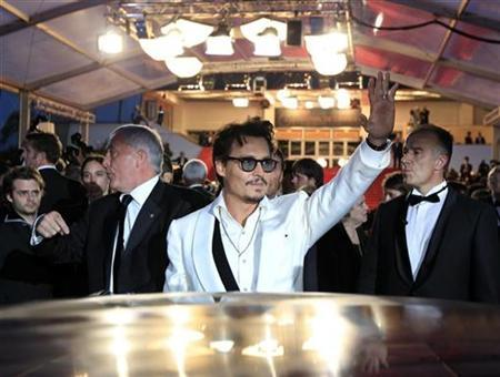 Cast member Johnny Depp leaves the Festival Palace after the screening of the film ''Pirates Of The Caribbean: On Stranger Tides'' at the 64th Cannes Film Festival, May 14, 2011.                REUTERS/Jean-Paul Pelissier