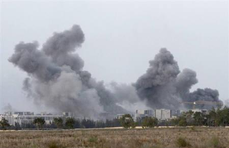 Heavy smoke rises from Sirte city after NATO bombing of the positions of Gaddafi loyalists during heavy fighting with anti-Gaddafi forces, as they push forward towards the centre of Sirte October 7, 2011.  REUTERS/Anis Mili