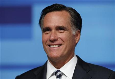 Former Massachusetts Governor Mitt Romney smiles before the start of the Republican Party of Florida presidential candidates debate in Orlando, Florida, September 22, 2011. REUTERS/Scott Audette