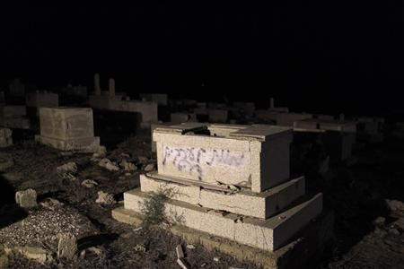 Graffiti is seen on a gravestone in a cemetery in Jaffa, just south of central Tel Aviv, October 8, 2011. The graffiti reads: ''death to Arabs'', Jaffa is the ancient part of Tel Aviv which has a mixed Arab and Jewish population. REUTERS/Ammar Awad
