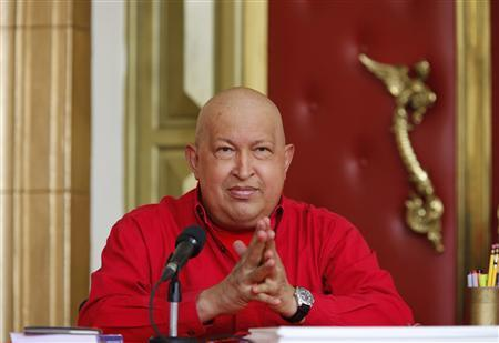 Venezuela's President Hugo Chavez takes part in a meeting with members of the political coalition ''Great Patriotic Pole'' at Miraflores Palace in Caracas October 8, 2011.  REUTERS/Miraflores Palace/Handout