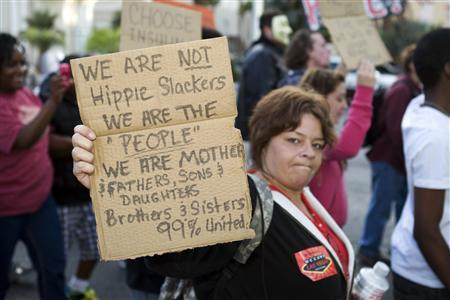 A woman who identified herself as Janelle K. holds up a sign during an ''Occupy Las Vegas'' demonstration on the Las Vegas Strip, October 6, 2011. REUTERS/Las Vegas Sun/Steve Marcus