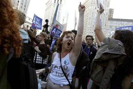 An Occupy Wall Street protester shouts slogans as she demonstrates in Foley Square in New York City, October 5, 2011.   REUTERS/Mike Segar