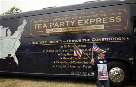 A man carries a U.S. flag during a Tea Party rally in Napa, California, August 27, 2011. REUTERS/Robert Galbraith