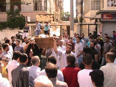 Mourners carry a coffin during the funeral of a protester killed in earlier clashes in the Syrian city of Homs October 7, 2011.    REUTERS/Handout
