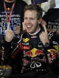 Piloto da Red Bull Sebastian Vettel, o mais novo bicampeão mundial da história da Fórmula 1. 09/10/2011  REUTERS/Toru Hanai