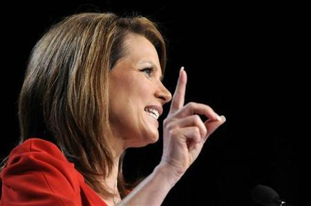Republican U.S. presidential candidate Representative Michele Bachmann (R-MN) gestures as she speaks during the Family Research Council's Values Voters Summit in Washington, October 7, 2011.  REUTERS/Jonathan Ernst